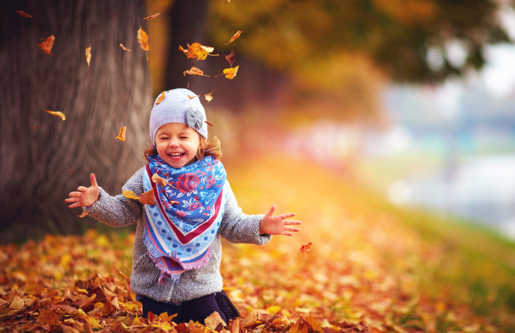 girl enjoying fall fun